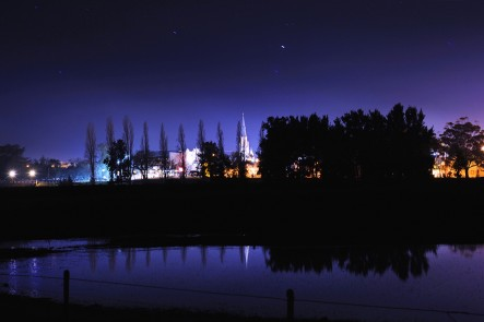 A night photo of the Mudgee Skyline and reflection