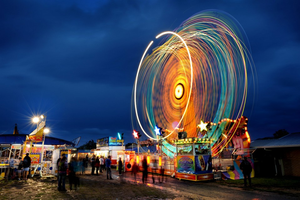 A twilight photo of amusement rides at the Mudgee Showw. Photo by Amber Hooper