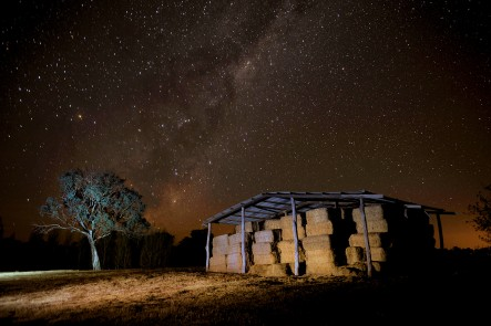 A photo of the Milky Way and old hay shed. Photo by Amber Hooper.